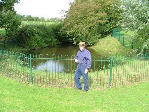 A photo of Gramps posing by the pond on John Benbow's farm in Herefordshire, Englan