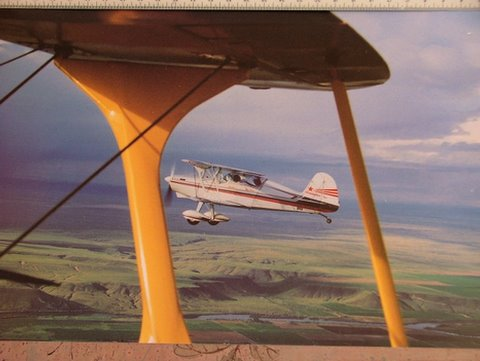 "A photo of the plane ""Acroduster Too"" from the plane ""Starduster Too""."