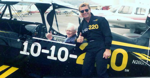 A photo of Gramps in the Starduster plane with Sean Tucker standing beside it.