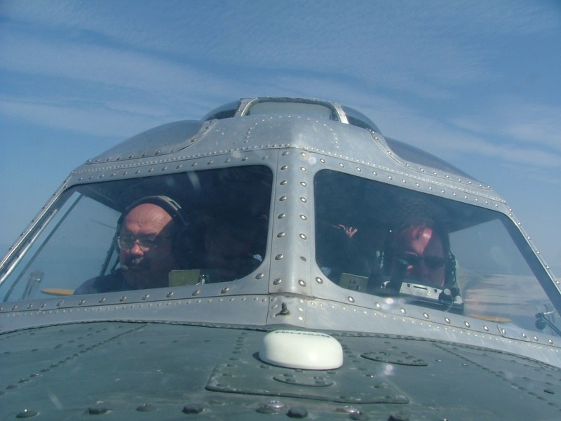 A photo taken by the navigator bubble in the plane Starduster, showing the pilots.